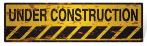Under Construction yellow and black sign