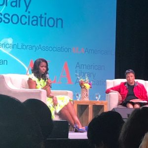 Michelle Obama and Carla Hayden seated on stage