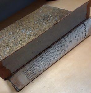 spine open revealing hidden text